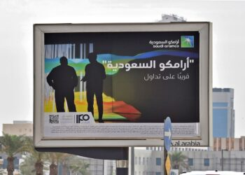 A billboard displaying an advert for Aramco is pictured in the Saudi capital Riyadh on November 11, 2019. - From robots to sniffer drones, Saudi Aramco has ramped up spending on technological innovation while its rivals cut back amid soft oil prices, but the energy giant risks losing its edge after its much-anticipated IPO. Saudi Arabia is offering a sliver of the company, touted as the kingdom's crown jewel, in its upcoming initial public offering that is the bedrock of Crown Prince Mohammed bin Salman's ambitious strategy to overhaul the oil-reliant economy. (Photo by FAYEZ NURELDINE / AFP) (Photo by FAYEZ NURELDINE/AFP via Getty Images)