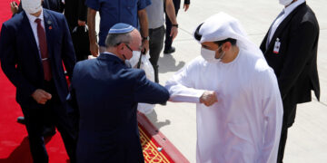 Israeli National Security Advisor Meir Ben-Shabbat elbow bumps with an Emirati official as he makes his way to board the plane to leave Abu Dhabi, United Arab Emirates September 1, 2020. REUTERS/Nir Elias/Pool