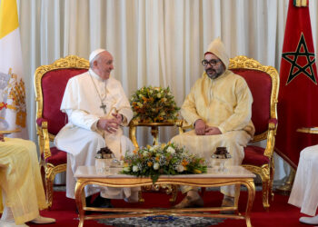 Pope Francis chats with King Mohammed VI after arriving at Rabat-Sale Airport in Morocco March 30, 2019. (CNS photo/ Vatican Media via Reuters) See POPE-MOROCCO-ARRIVE March 30, 2019.
