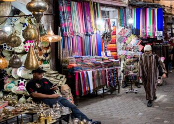 Marrakech, France, 19 October 2019. Locals wandering through the alleys of the souk. (Photo by Emeric Fohlen/NurPhoto via Getty Images)