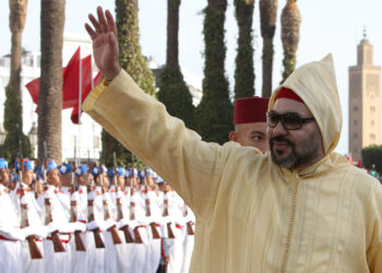 Moroccan King Mohammed VI flanked by the crown prince Moulay Hassan back waves to the crowd as he arrives to the the opening session in the Morocco Parliament in Rabat, on Friday, Oct. 12, 2018. King Mohamed VI outlined policies for the new parliamentary session. (AP Photo/Abdeljalil Bounhar)